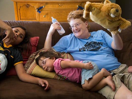 Loren Wise, mother of nine adopted children (soon to be 10) hangs out in her Phoenix home with Jayden, 9,  left, and Gabrielle, 2, on a Saturday afternoon.