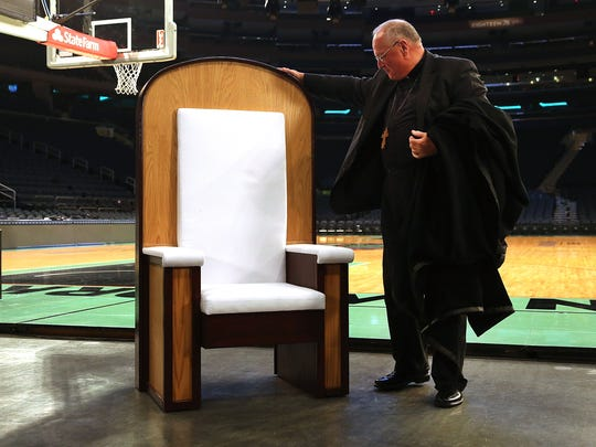 Cardinal Timothy Dolan unveils the chair Pope Francis