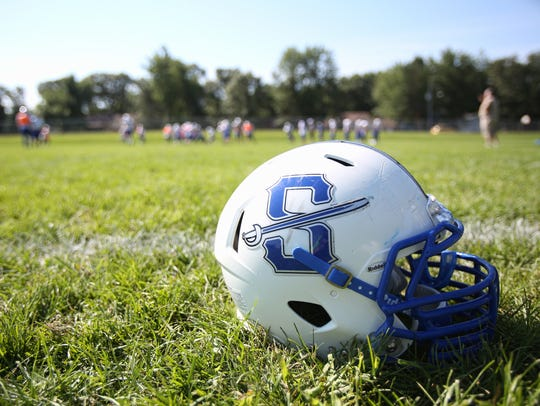 Sartell players gather Wednesday, Aug. 24, on their