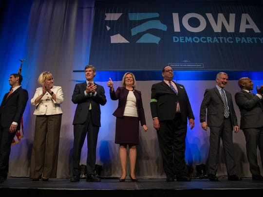 All seven Democratic candidates for governor, Nate Boulton, Cathy Glasson, Fred Hubbell, Andy McGuire, Jon Neiderbach (no longer in race), John Norris and Ross Wilburn take the stage during the Iowa Democratic Party's fall gala on Monday, Nov. 27, 2017, at Hy-Vee Hall in Des Moines.