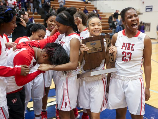 Pike players celebrate with the sectional trophy after