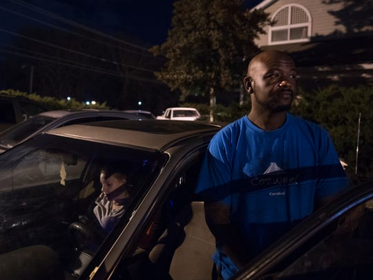 JC Wright waits in his car to be checked into the InTown
