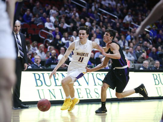 Waukee's Jackson Payne brings the ball down the court