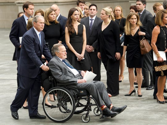 Former President George H.W. Bush, and his son, former President George W. Bush, leave St. Martin's Episcopal Church following the funeral of Barbara Bush in Houston.