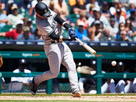 New York Yankees left fielder Clint Frazier (77) hits