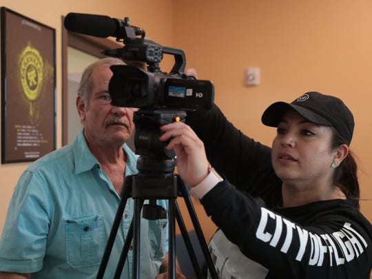 Vanessa Nassar, right, adjusts a tripod with Rick Sturms. The two are participating in DIGICOM's video production training program for Palm Springs Unified teachers, Palm Springs, Calif., June 13, 2018.