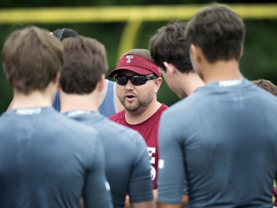 Tate head coach Jay Lindsey coaches the Aggies during a summer workout.