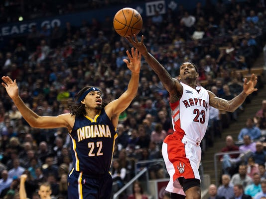 Toronto Raptors guard Lou Williams (23) drives the net past Indiana Pacers forward Chris Copeland (22) during first half of their NBA basketball game in Toronto on Friday, Dec. 12, 2014. (AP Photo/The Canadian Press, Nathan Denette)
