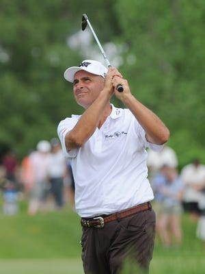 Rocco Mediate watches his shot on the 18th hole during the second round of the Senior PGA Championship golf tournament, Friday.