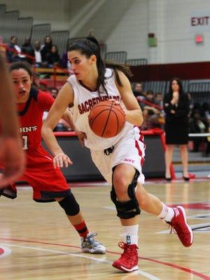 Harpursville graduate Hannah Kimmel, seen here dribbling against St. John's in a 2013 game, is averaging 16 points and 6.3 rebounds for Sacred Heart this season.