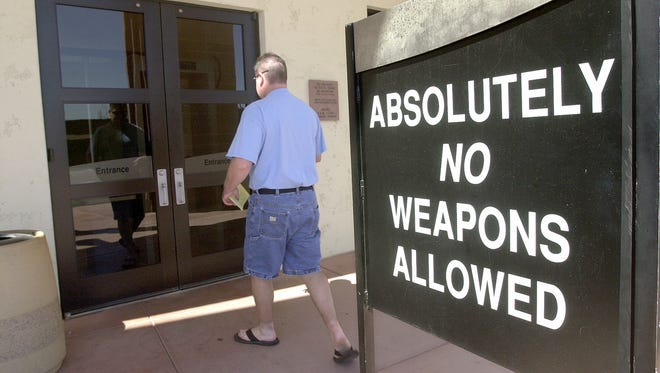 Scottsdale Justice Center has this sign out front warning the public about bringing weapons inside the building.