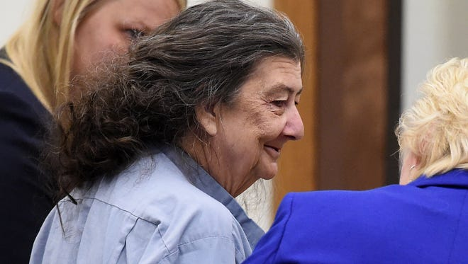 Cathy Woods, center, who had been imprisoned of more than 30 years, smiles with her lawyers while in a Wahoe district court in Reno, Nev. on Sept. 8, 2014 where she was granted a new trial based on recently evaluated DNA evidence in the 1976 murder.