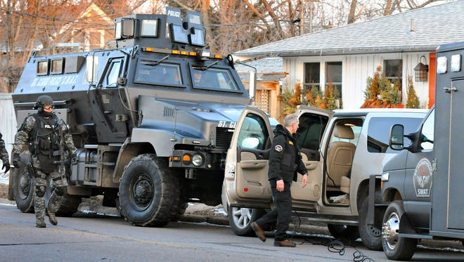 Police in St. Cloud, Minn., use a military vehicle during a standoff in April.