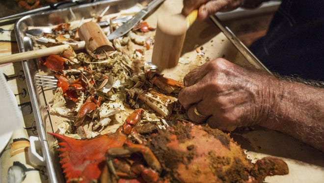 Jimmy Gambacorta breaks into a steamed blue crab claw at Mrs. Robino's in Wilmington's Little Italy.