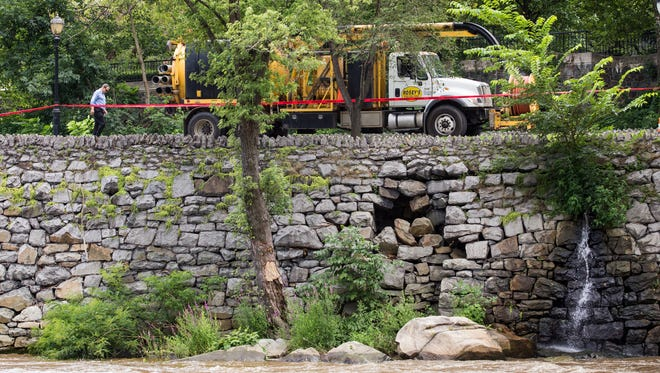 A hole developed in a retaining wall along the Brandywine, closing South Park Drive near the Market Street Bridge, Monday, July 28, 2014.