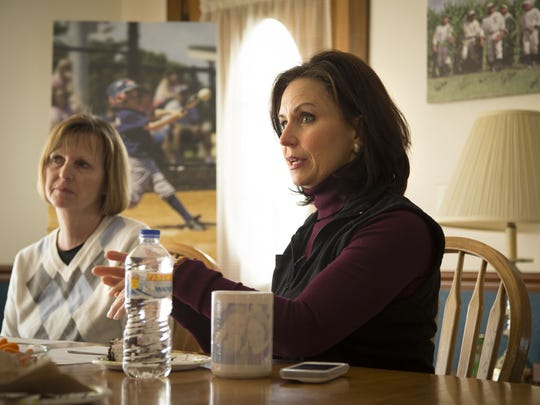 Denise Stillman, right, CEO of Go the Distance LLC, holds a staff meeting at the Field of Dreams farmhouse March 31, 2014, before opening the film site for visitors April 1.