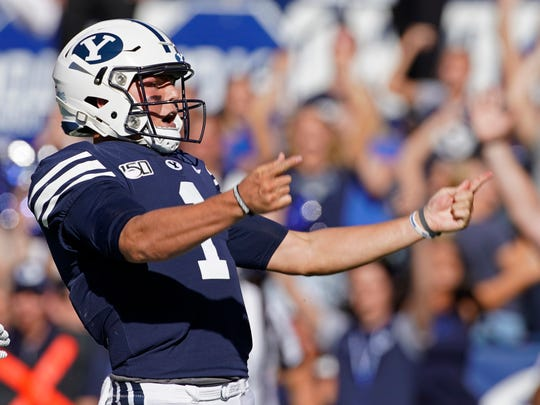 BYU quarterback Zach Wilson (1) celebrates a touchdown in the second half of an NCAA college football game against Southern California, Saturday, Sept. 14, 2019, in Provo, Utah. BYU defeated USC 30-27. (AP Photo/George Frey)