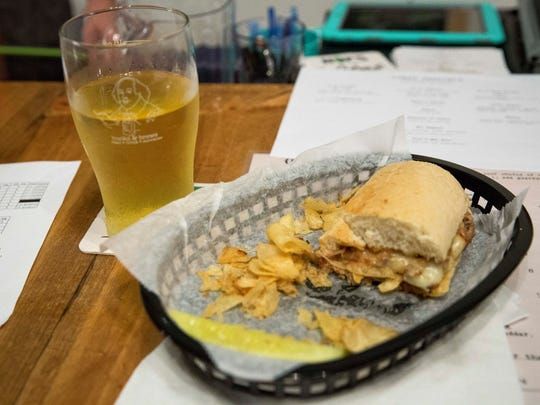 A beer, chips and pulled pork sandwich are just one of dozens of combinations at Books & Brews at 2100 W. White River Blvd.
