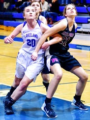 Lakeland's Megan Depolo (left) jostles for rebound