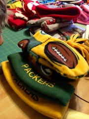 It's no surprise that Ann Fruzen's biggest sellers are Green Bay Packers and Wisconsin Badgers mittens, hats and scarves, but she also sews a few items for Minnesota Vikings, Chicago Bears and Detroit Lions