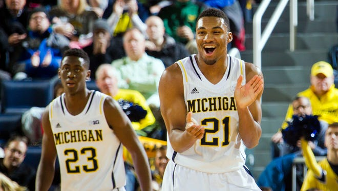 Michigan guard Zak Irvin (21) reacts after a basket at the end of the first half against Detroit Mercy in Ann Arbor one Thursday, Nov. 20, 2014.