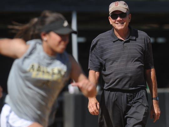 Abilene High softball coach Jim Reese, right, watches as his players run the bases during practice Wednesday.