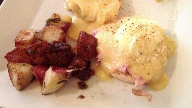 Cafe Dodici's Eggs Benedict ($12.12) is classically prepared with two poached eggs and Virginia baked ham atop English muffins, smothered in hollandaise sauce, served with rosemary potatoes.