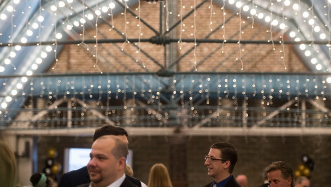 Attendees mingle during the News Sentinel's 2018 Top Work Places awards ceremony at the Foundry in World's Fair Park Tuesday, June 19, 2018.