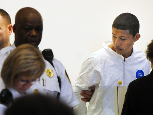 Philip Chism, 14, stands during his arraignment for the death of Danvers High School teacher Colleen Ritzer in Salem, Mass., court on Oct. 23.