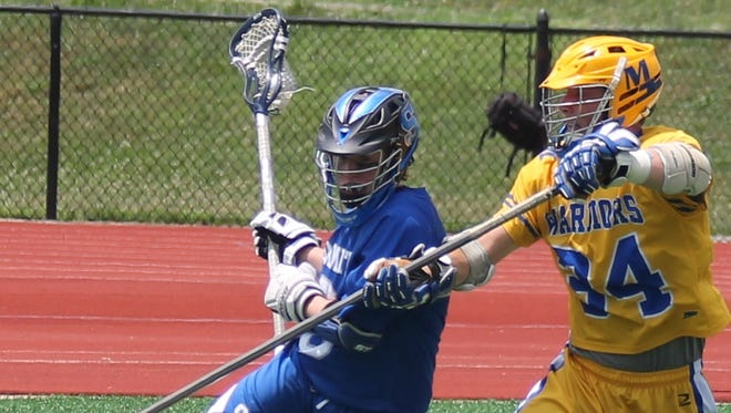 Mariemont senior Parker Sullivan prevents his man from going to the inside during the Warriors' 13-6 regional championship victory against Summit Country Day May 30 at Kings.
