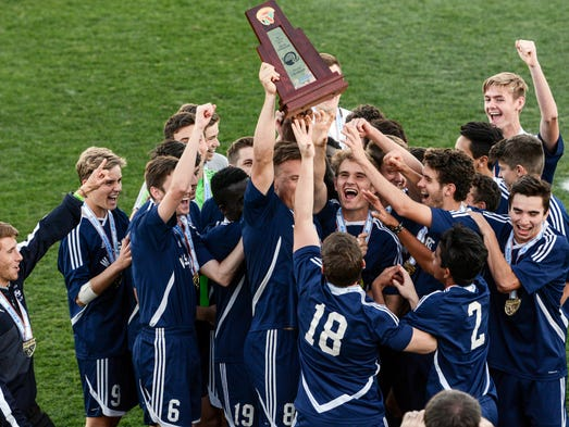 West Shore players hold up the Class 1A championship