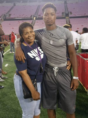 Louisville 2017 WR recruiting target Corey Reed and his mother, Tereka Tisinger, after U of L's Light Up The Ville camp on July 15, 2016.