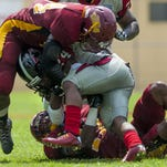 Tuskegee's Jason Ashley (44) and Julian Morgan (17) stop Clark Atlanta's Malik Spikener on Sept. 5, 2015. Morgan's goal is to go unbeaten.