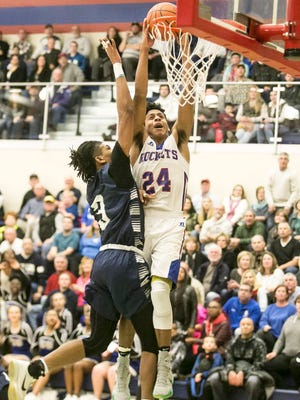 Spring Grove's Eli Brooks gets fouled by Dallastown's Justin Atwood, while going up for the dunk, during the fourth quarter of a basketball game Friday, Jan. 6, 2017, at Spring Grove Area High School. Spring Grove won 70-59. Amanda J. Cain photo