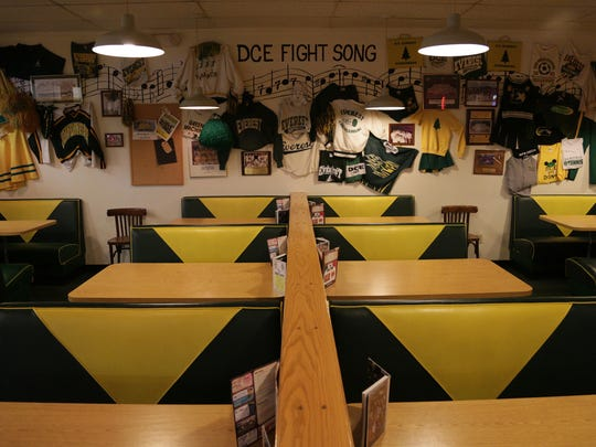 The interior at Sam's Pizza in Schofield is themed for D.C. Everest High School.