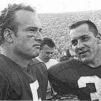 Green Bay Packers halfback Paul Hornung, left, and running back Jim Taylor stand on the sideline during Super Bowl I in Los Angeles on Jan. 16, 1967.