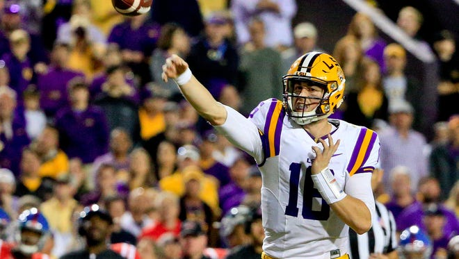 Oct 22, 2016; Baton Rouge, LA, USA; LSU Tigers quarterback Danny Etling (16) throws against the Mississippi Rebels during the second half of a game at Tiger Stadium. LSU defeated Mississippi 38-21. Mandatory Credit: Derick E. Hingle-USA TODAY Sports