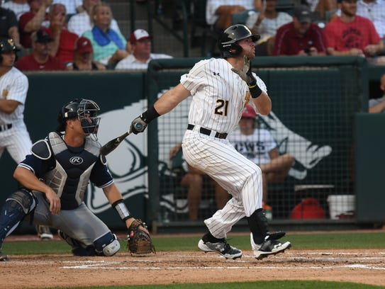 Southern Miss' Hunter Slater watches his home run fly