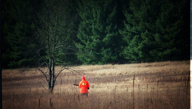 In this file photo, a deer hunter keeps his eyes on a tree line adjacent to a field. A deer hunter (not pictured) accidentally shot and injured a duck hunter in the town of Oconomowoc recently.