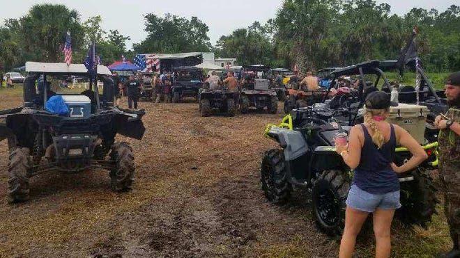 Rolling up in ATV's, music lovers brave the weather to attend the Band-Aid Festival at the Florida Cracker Ranch over the weekend.
