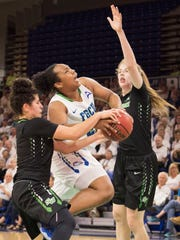 China Dow of Florida Gulf Coast University battles for possession against McKenna Beach of Stetson, left, as Sarah Sagerer defends during the game at FGCU Saturday night, February 24, 2017. A jump ball was called on the play.