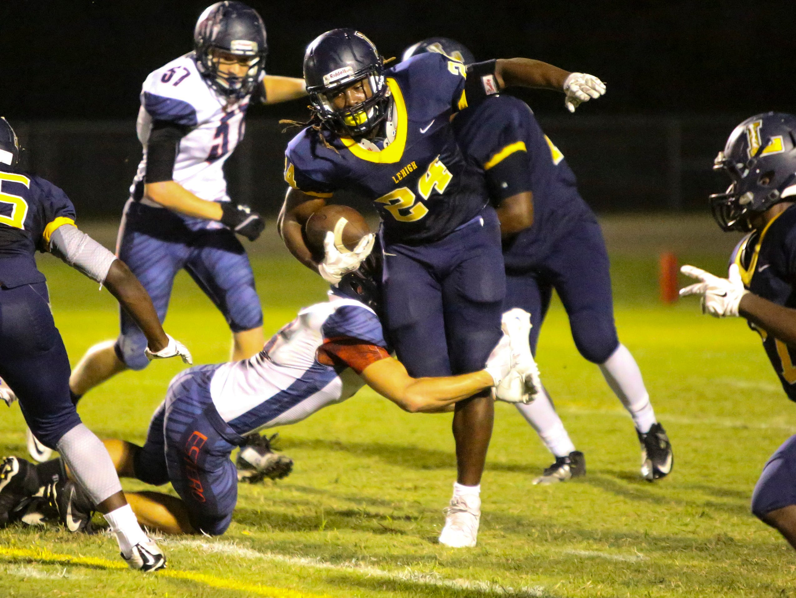 Lehigh's Chris Curry gains yards for the lightning early in their game against Estero. Estero went on to win 21-7.