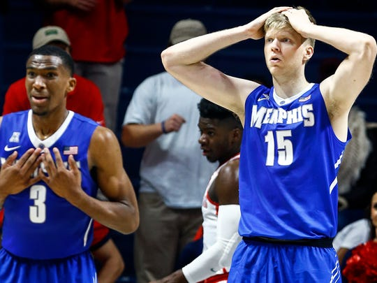 University of Memphis teammates Jeremiah Martin (left) and Chad Rykhoek (right) react to an official's foul call during second-half action against Ole Miss at The Pavilion in Oxford, Mississippi, Saturday.