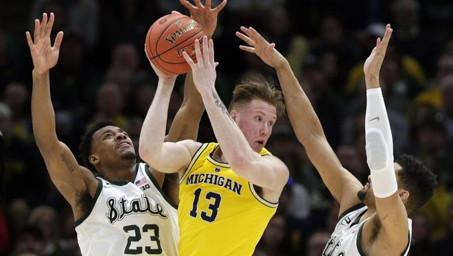 Michigan State, which won the Big Ten tournament title, moved up one spot to No. 5, while Michigan moved up two spots to No. 8 in the final Associated Press Top 25 poll.