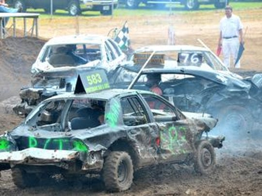 Competitors compete in the 2013 demolition derby during the Wausau Area Jaycees' 68th annual Fourth of July celebration at the Marathon County Park in Wausau.