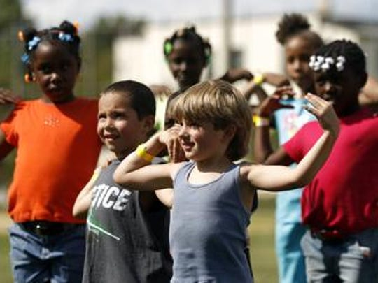 """Children playing """"Simon Says"""" during a Linden Family Unity Day event in 2007."""