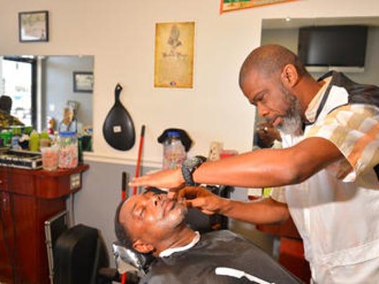 Robert Tyson gives regular customer Sylvester Bowers