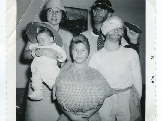 Micky, Sonny and their kids, from left, Greg, Gary and Michael, at a Halloween party in 1961.