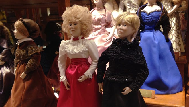 Dolls wearing the 2011, right front, and 1983, center, inaugural gown of Iowa first lady Chris Branstad in a case displaying the gowns of first ladies in the Iowa State Capitol in Des Moines.