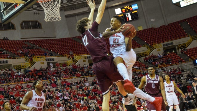 Shawn Long goes up strong to the goal as the UL Ragin' Cajuns basketball team lost to first-place Little Rock.